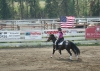 American Flag being carried by Cariboo cowgirl