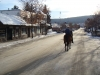 Christmas Day. John my Husband Riding Boo down the middle of downtown 100 Mile House
